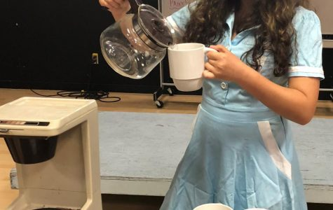 Singing as she pours coffee, sophomore Sydney Alvarez rehearses for