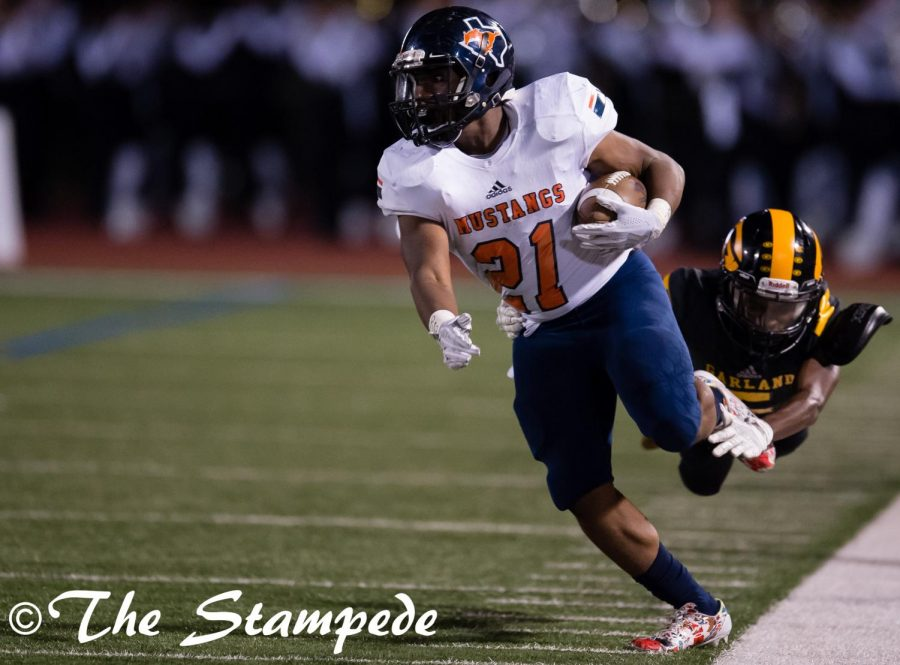 Senior running back KJ Williams breaks away from a Garland defender.