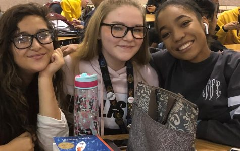 "Sophomore Sydney Alvarez with sophomore Kaitly Collins - ""I'm thankful for my family and my friends especially Kristin Gooding;"" and junior Liyah Williams - ""I'm thankful for food and that Jesus loves me."""