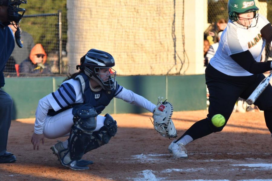 Catcher Skyler Rheaume does her job against Naaman Forest on March 5.  The Mustangs defeated Naaman Forest 22-0 in three innings.