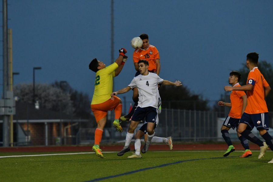 Senior Johann Infante leaps over his opponent.