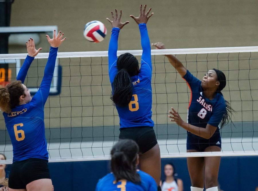 Senior Alicia Hearn outmaneuvers her opponents in a game against Lakeview Centennial last year.