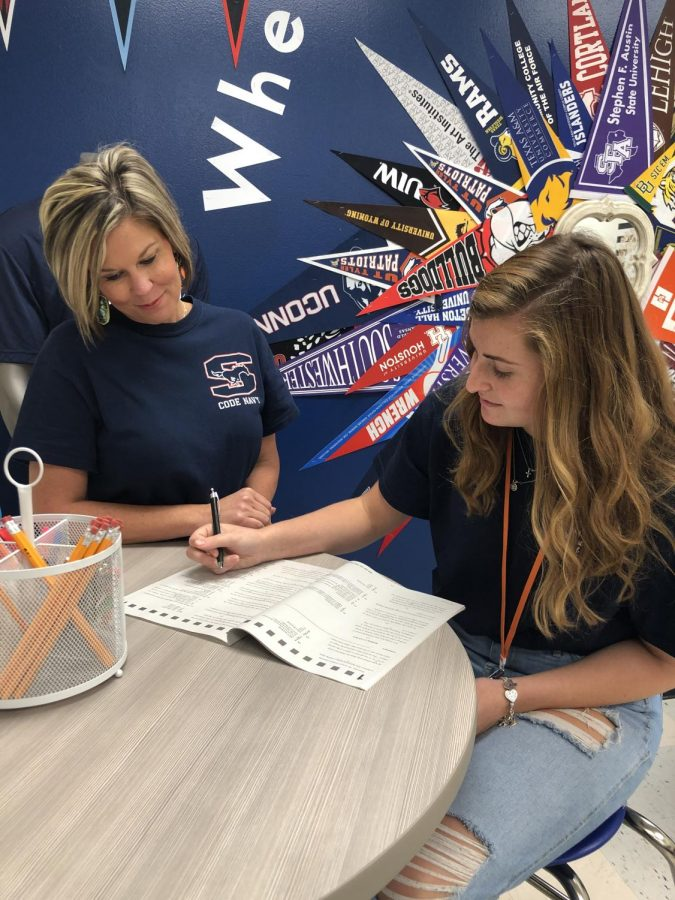 Go center counselor Sarah Thrash helps senior Emily Erickson through an ACT workbook.
