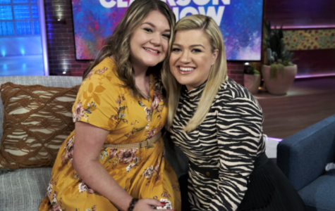 Freshman Peyton Mullins poses with talk show host Kelly Clarkson after the taping of the show.