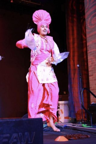 Freshman Manny Chatrath dances at The Plano Convention Center for Vaisakhi mela with his Bhangra team Sheran Di Kaum.