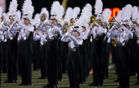 Band members perform at the halftime show of the game against Garland.