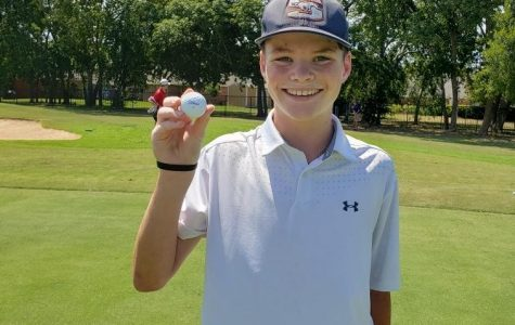 Sophomore Camden Rafferty shows off the ball he used to hit his hole-in-one.