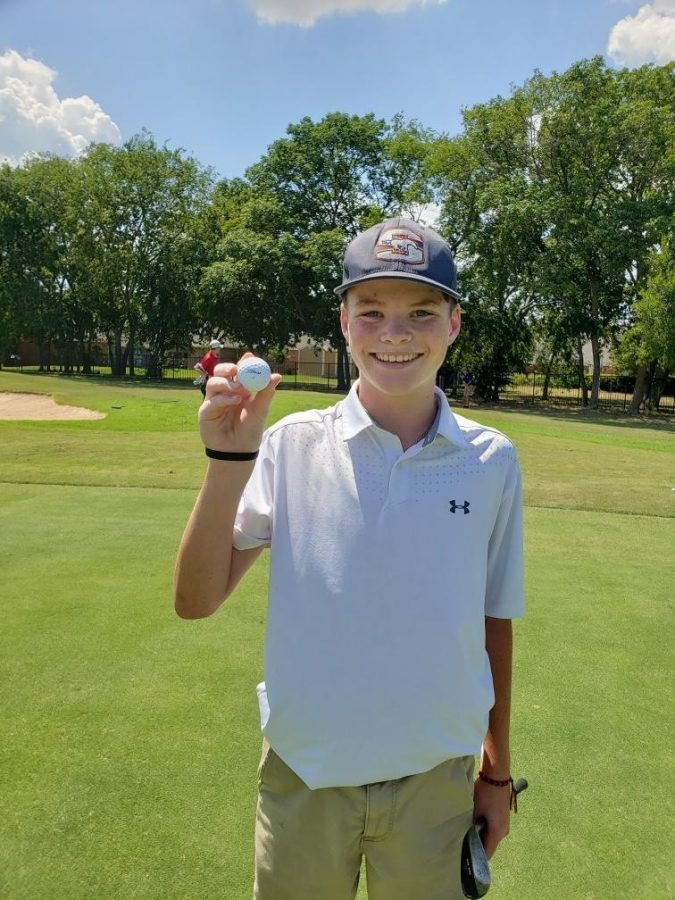 Sophomore+Camden+Rafferty+shows+off+the+ball+he+used+to+hit+his+hole-in-one.