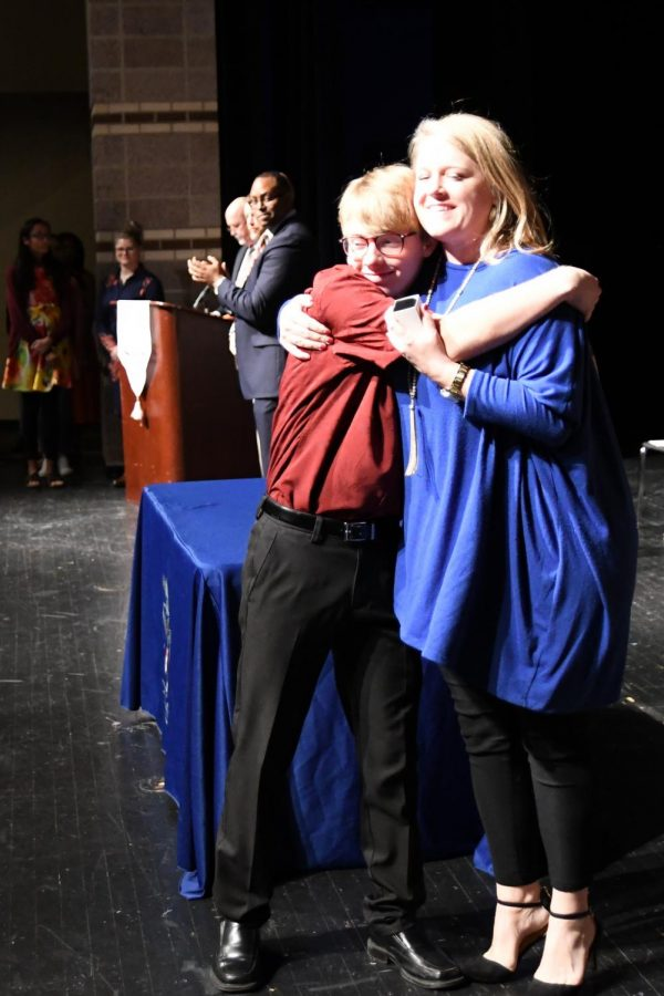 Junior Matthew Story receives his ring from teacher Elizabeth Murdock at the inaugural SHS junior ring ceremony.