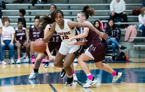 Senior Tia Harvey evades her opponent in the game against Rowlett. Harvey had 10 points in the game.