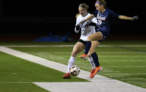 Junior Chayse Thorn fights for possession in the first game against Wylie.
