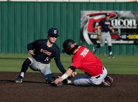 Second baseman senior Hayden Ingram tags out a Rockwall Heath player.