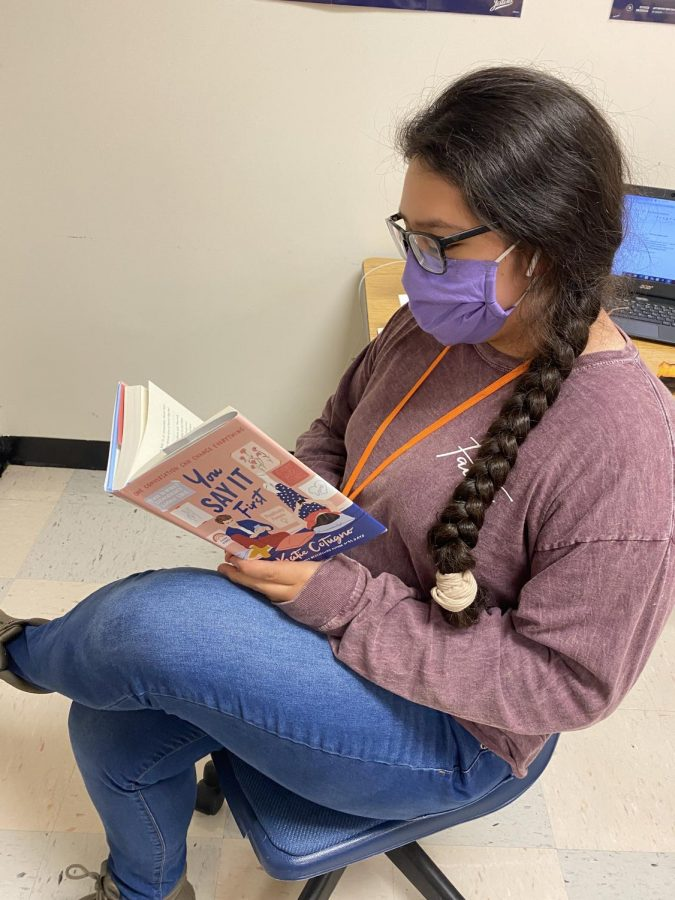 Senior Stephanie Gonzalez enjoys a book during Mustangs Read.