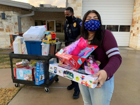 BETA Club officer and senior Diana Dominguez Castro drops off collected toys at the Sachse Police Station.