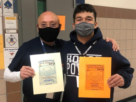 Spanish teacher Jorge Sanchez-Gomez and freshman Salomon Halaby