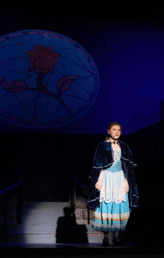 Senior Kaitlyn Collins sings during last year's production of