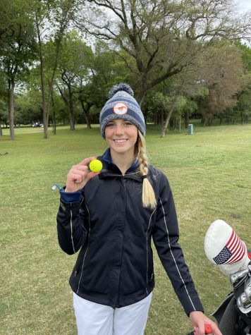 Sophomore Ally Cheek displays her hole-in-one ball.