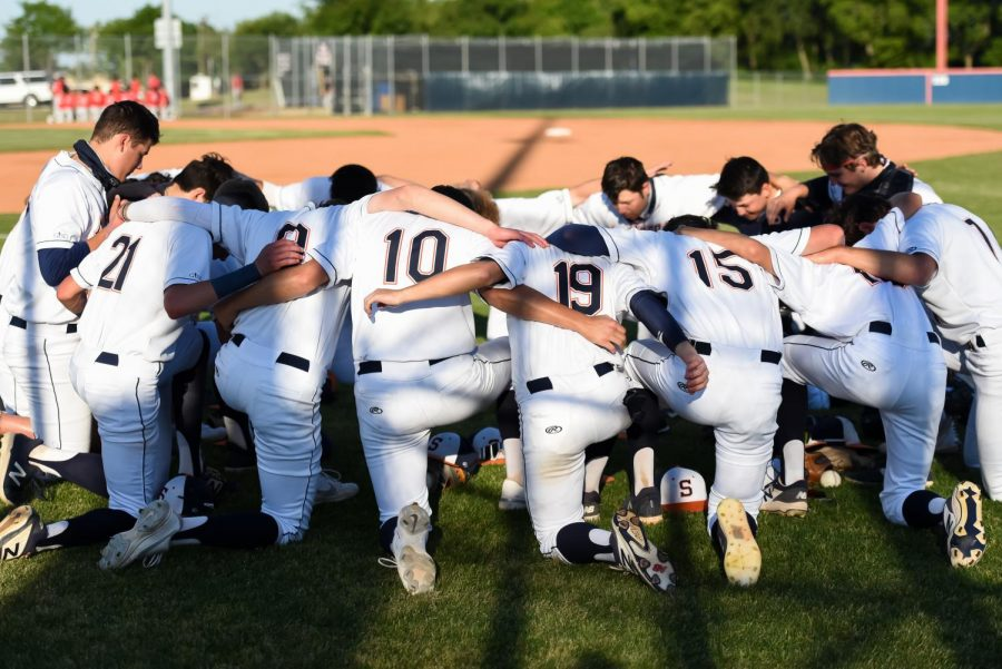 The varsity baseball team prepares for the first round of the playoffs against Tyler Legacy.